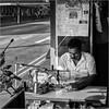 Tailor brother (John Riper) Tags: johnriper street photography straatfotografie square vierkant bw black white zwartwit mono monochrome singapore candid john riper xt2 fujifilm xf18135 little india tailor taylor man calendar sewing machine drone moustache