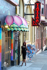 Blais (Levi Smith Photography) Tags: tattoo parlor neon color haight ashbury pink woman beautiful dress black african american graffiti fashion pose women lady womans womens clothing advertisement street building legs body girl