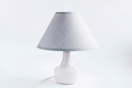 Grey home lamp on white background .