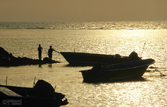 Sunset over Persian Gulf (Mahmoud R Maheri) Tags: sunset persiangulf iran bushehr boats silhouette sea water fishermen