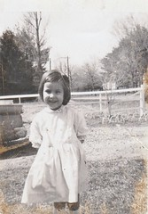 LITTLE SYLVIA ON EASTER SUNDAY 1966 (richie 59) Tags: ulstercountyny ulstercounty newyorkstate newyork unitedstates trees townofesopusny townofesopus richie59 stremyny stremy america outside oldphotograph olddays oldpicture oldphoto film photoscan sister filmcamera filmphotography person child girl photograph photo childhood oldtime april1966 1966 april101966 1960s hudsonvalley midhudsonvalley midhudson ny nys nystate usa us frontyard yard driveway grass graval easter eastersunday fence woodenfence ford fomoco fordmotorcompany fordfairlane 1959fordfairlane 1959fairlane 1959ford fairlane neighborhood