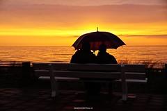 DSC05076 (ZANDVOORTfoto.nl) Tags: sunset zon zandvoort paraplu umbrella rain regen strand zand aan zee bankje couch sunny rainy beach sea kust nederland netherlands