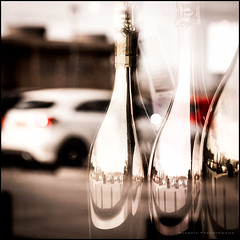 Champagne reflection (G. Postlethwaite esq.) Tags: baranddining boardwalk dof derbyshire findern macro willington beyondbokeh bokeh bottle cars champagne closeup depthoffield fizz fullframe photoborder selectivefocus window