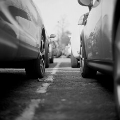 Parked (Gabo Barreto) Tags: cars car wheels carpark reflection wetherby film 120 mediumformat analoguephotography monochrome foma kiev88 vega12b fomapan100 d76 blackandwhite selfdeveloped filmisnotdead slr singlelensreflex 6x6 scannedfromfilm sovietcamera commiecamera