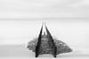 Breskens (Schotje) Tags: noordzee breskens nederland zee zand zeelandschap keien palen langesluitertijd zwartwit
