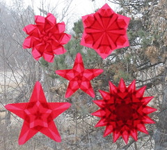 Red Window Stars (Pictures by Ann) Tags: etsy harvestmoonbyhand windowstars window stars patterns five 5 valentinesday christmas love wedding passion craft art project creativeexpression origami kitepaper winter hot crimson ruby rubyred decoration decor