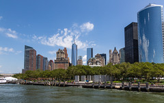 Battery Park, New York (Oleg.A) Tags: sunny cyan window megalopolis water city cityscape aqua midday viewpoint batterypark tower architecture park usa newyork landscape old people brick vintage panorama materials town exterior blue colorful manhattan summer nature style design island sky building outdoor hudsonriver orange street