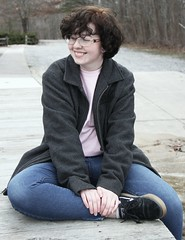 smile, you are beautiful (doctor12queen) Tags: nonbinary glasses deck park coat blackhair ginger smile happy positive portraits girl male sitting outside nature natural water pretty cute handsome
