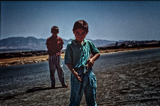 Kid playing soldier in a country where war is real