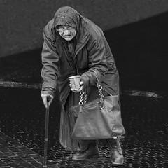 Homeless old woman (Ales Dusa) Tags: homeless beggar homelessoldwoman blackandwhite bw streetphoto poorwoman human humanity poverty streetshot streetportrait alesdusa ef70300mmf456lisusm plight people monochrome street elderly beggarwoman scarf stick glasses oldwrinkledwoman wrinkles canoneos5dm2
