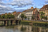 ESTRASBURGO II   -   STRASBOURG II (Miquel Fabré) Tags: miquelfabre estrasburgo estrasburg alsacia alsace francia france rio canal edificios edificiosantiguos casas puente river lock buildings oldbuidings houses bridge arboles people turism viaje trip travel color canon canoneos6dmarkii nubes clouds tejados rooftops chimneys ventanas windows tour paseo walk nwn ngc cielo agua