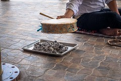 heating up the drum with charcoals for the Yaqui deer dance.