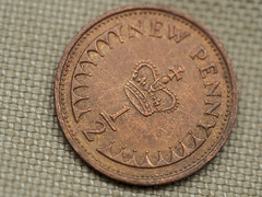 Who remembers this cute little coin? (me.behindthelens) Tags: macromondays backintheday money coin