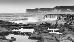 Rocky Seascape in Black and White (Merrillie) Tags: daybreak sunrise northavoca nature water rocky blackandwhite rocks centralcoast morning newsouthwales waves earlymorning nsw sea avocabeach ocean monochrome landscape northavocabeach coastal waterscape sky seascape australia coast dawn outdoors