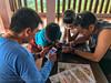 Exchanging photos (Stinkee Beek) Tags: lombok adi leonard erin ethan