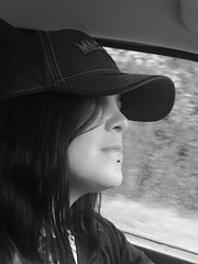 Driving in the rain. (kegrose) Tags: water rain solitude thought girl driving pierced beautiful woman