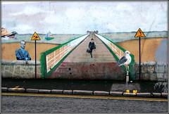 Silly Walks on a Wall (* RICHARD M (Over 7 MILLION VIEWS)) Tags: street mural graffiti art streetart publicart artwork ministryofsillywalks montypythonsflyingcircus johncleese humour fun silly westonsupermare northsomerset somerset pier piers sillywalk montypython lol doubleyellowlines pavement tarmac kerb kerbstones gutter seagull seaside silliness gableend sidestreet westonsupermarepier seasideresorts comic comical lifeboat
