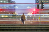 Waitng at the Crossing (adrians_art) Tags: movement longexposure transport trains buses london city night people stations docklands urban uk england lines abstract red blue black white isleofdogs