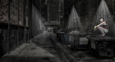 Alleyway (brian_stoddart) Tags: america light lamp nightime dark noir rays bins truck buildings figure lonely