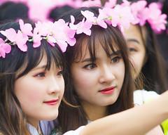 Hanoi Fresh Graduates (Reef_Wreck) Tags: hanoi vietnam graduates youth school lady pink flowers street