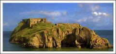 Fort St Catherine(Wales) (williamwalton001) Tags: pentaxart island historic framed fineart fort colourimage clouds coastal rocks sun sky cloud stone
