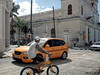 Transports (Jean S..) Tags: transportation bicycle cars taxi yellow street streetphotography candid building clouds sky white blue