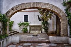 A Quiet Corner (Jocelyn777) Tags: arch foliage patio patioandaluz alcazar seville andalucia spain monuments travel textured