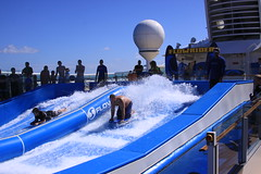 Flowriding on Navigator of the Sea's cruise (miosoleegrant2) Tags: flowriding water ride waves male men mature guy senior bare naked shirtless chest flowrider flowboarding flow riding riders boarder wave house surf rider machine surfing fake sport outdoor man hands guys blue pits armpits thighs hairy legs cruise backs shorts wet arms swimwear feet people stud studs dude dudes virile manly masculine swim buags butt skytt sky