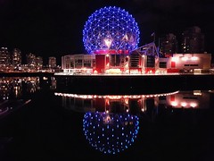 Telus World of Science (walneylad) Tags: vancouver britishcolumbia canada falsecreek telusworldofscience scienceworld geodesicdome building city urban condos cityscape night evening dark lights water reflections blue red