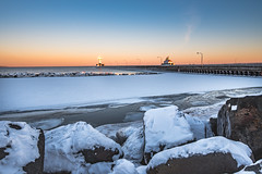 Duluth Lighthouse, Minnesota in Winter (Tony Webster) Tags: duluth duluthnorthpierlighthouse lakesuperior minnesota ice lighthouse snow sunset winter