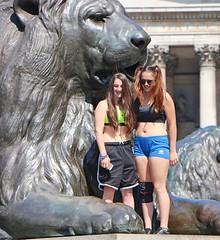 Sports Girls (Waterford_Man) Tags: girls glasses sporty shorts bare midriff midrift sportsbra london candid people tourists mobile phone