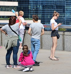Levis Waiting (Waterford_Man) Tags: levis girl thin mobile glasses legs people path candid london