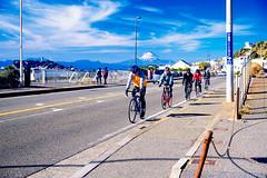 Bike rides on the Shichigori beach in Kamakura (Dakiny) Tags: 2018 winter january japan kanagawa kamakuira shichirigaham shonan coast city street landscape mountain mountfuji sky people road bicycle cyclist biker rider
