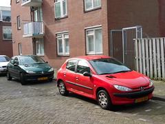 Peugeot 206 1.1 (red) (24 11 2004) Peugeot 206 1.6 (green) (04 07 2002) (brizeehenri) Tags: peugeot 206 2002 2004 21psbn 82jnvz schiedam