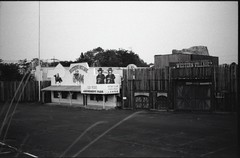 (✞bens▲n) Tags: pentax mzs kodak tmax 400 at1600 fa 43mm f19 limited film analogue blackandwhite japan tocigi haikyo abandoned amusement park parking lot entrance cowboys horses western village