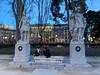 Evening Conversation in Plaza de Oriente (David J. Greer) Tags: madrid spain woman girls women gals statue bench sit talk walkway dusk
