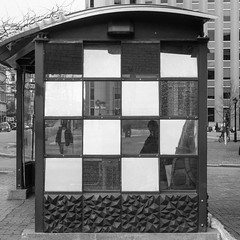 Congress Square Bus Stop in Black and White (Corey Templeton) Tags: bus city congressstreet maine metro monumentsquare newengland other portland portlandmaine portlandpublicartcommittee publicart sidewalk winter unitedstates