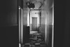 we.move.between.two.darknesses (jonathancastellino) Tags: toronto abandoned derelict decay ruin ruins leica q hotel motel hall hallway camera cctv tile doorway collapse