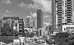 Le métro (bientôt) (rknecht) Tags: canon650d canonefs24mm city buildings sky clouds israel telaviv noiretblanc blackandwhite monochrome urban streetphoto photoderue street rue chantier work