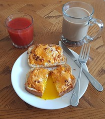 Eggs baked on bread with bacon, peppers and cheddar (canadianlookin) Tags: bakedeggs toast breakfast juice cheese