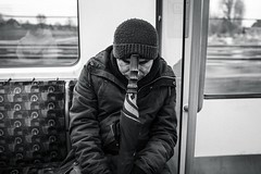are we there yet? (jrockar) Tags: urban city london westfromeast ordinarymadness madness ordinary idiot janrockar jrockar x100f fujix x fujifilm fuji blackandwhite mono bw commute rest umbrella sleeping tube guy man instant moment decisive candid streetphotography streetphoto street