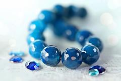 Blue Agate Stones (Through Serena's Lens) Tags: macrofriday lifeisarainbow hmm macromondays theblues dof bokeh blue handbracelet beads stones reflection tabletop lace stilllife agate