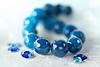 Blue Agate Stones (Through Serena's Lens) Tags: hmm macromondays theblues dof bokeh blue handbracelet beads stones reflection tabletop lace stilllife agate