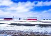 Saskatchewan farm (darletts56) Tags: sky blue clouds white sunny prairie barns silos red dirt brown buildings road field
