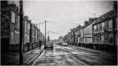 Grey Day (andystones64) Tags: communications phonecables poles telegraph easter april northlincolnshire nlincs lincolnshire scunthorpe rain weather streetview street road cars stranger walking urban photography