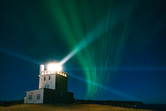 Dyrhólaey Lighthouse with Aurora (Matt Payne Photography) Tags: aurora auroraborealis beams coastal dyrhólaey green iceland landscape lightbeams loxia21 night nightscape stars lighthouse