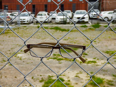 Do Fences Block Your View? (Steve Taylor (Photography)) Tags: glasses lense spectacles carpark fence chainlink brown green white red glass wire newzealand nz southisland canterbury christchurch cbd city grass
