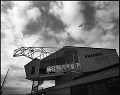 Soon to be a restaurant... (einarsoyland) Tags: rodinal restaurant bergen norway solheimsviken pentax67 smcp6745mmf40 clouds cloudscape sky crane industrial warped wide blackandwhite monochrome ishootfilm building architecture
