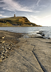 Kimmeridge Bay and Clavell Tower, Dorset (saffron100_uk) Tags: seascape landscape sea hill tower kimmeridgebay clavelltower dorset wessex jurassiccoast cliff rocks beach beachhuts hencliff nikon d700 clouds sky water landmarktrust clavellfolly