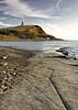Kimmeridge Bay and Clavell Tower, Dorset (saffron100_uk) Tags: seascape landscape sea hill tower kimmeridgebay clavelltower dorset wessex jurassiccoast cliff rocks beach beachhuts hencliff nikon d700 clouds sky water landmarktrust clavellfolly